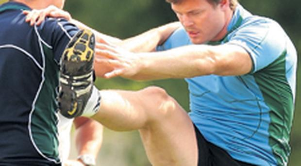 Fired-up Brian O'Driscoll limbers up in advance of tonight's crucial World Cup clash against France in Paris