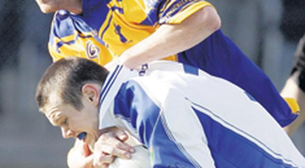 Coalisland's Peter Donnelly with Donaghmore's Darren Cush