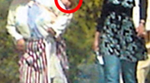 Photograph said to be taken by Spanish tourist Clara Torres in the town of Zinat in Morocco on August 31, 2007 shows a woman with a child on her back (circled) which she thought was missing British four-year-old Madeleine McCann