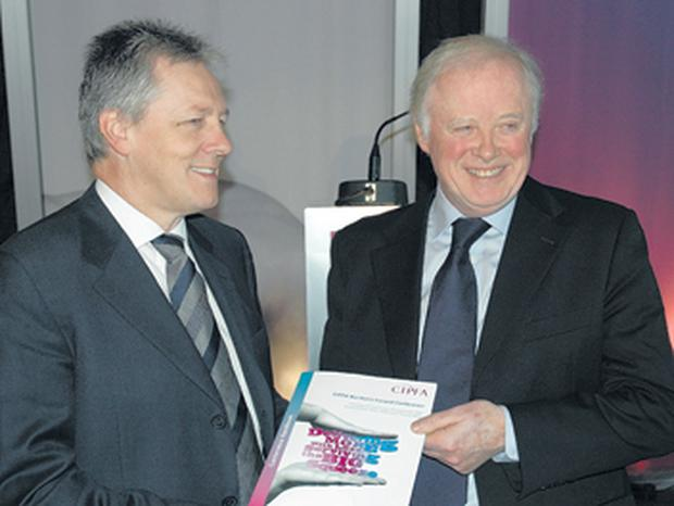 It's all in the name! Finance Minister Peter Robinson chats with celebrated business guru Sir Gerry Robinson, who is from Donegal, at the CIPFA conference at which the plan to set up a new watchdog body to achieve greater public sector efficiency was rolled out