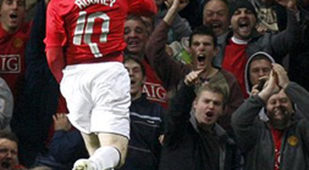 Rooney celebrates his winning goal at Old Trafford