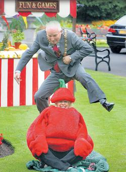 Belfast Lord Mayor Jim Rodgers attempts to jump over Lorraine Mallon