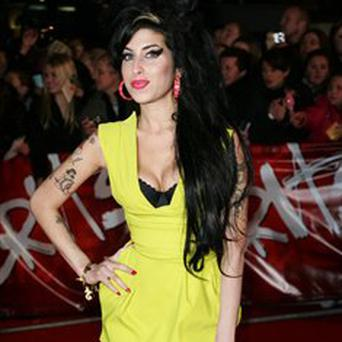 Amy Winehouse beat an otherwise all-male shortlist to win the best album prize at the Q Awards