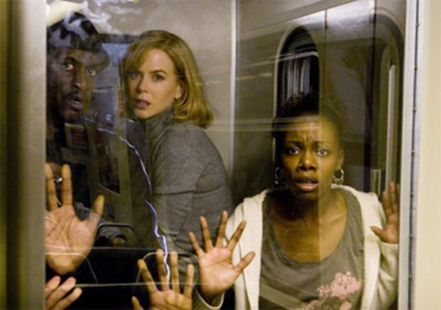 Pod people: Nicole Kidman (above centre) in 'The Invasion'