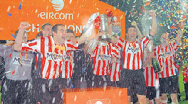 Derry City's players celebrate their extra time cup final victory