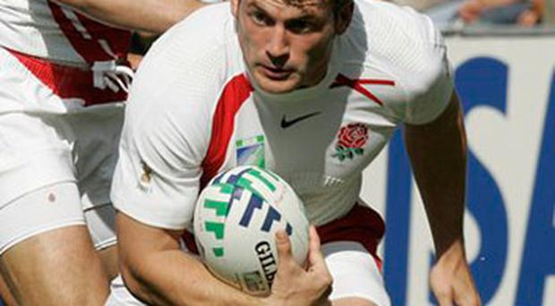 England's Mark Cueto runs with the ball during the Rugby World Cup Group A match between England and Samoa at the Beaujoire stadium in Nantes, western France