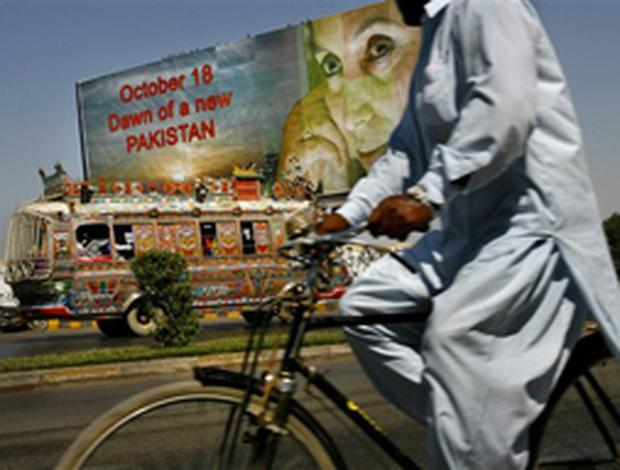 A billboard welcoming Pakistan's former Prime Minister Benazir Bhutto stands on a roadside near the international airport in Karachi, Pakistan