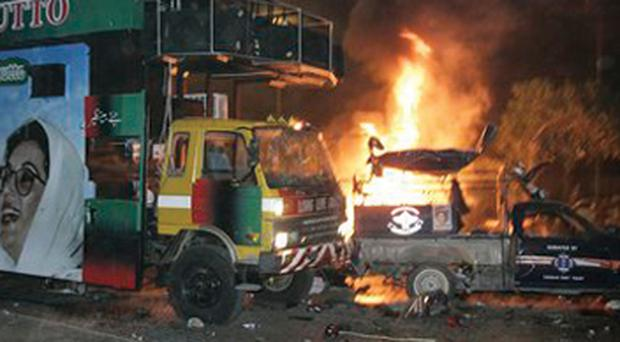 The truck of Pakistan former prime minister Benazir Bhutto is parked after an explosion in Karachi, Pakistan