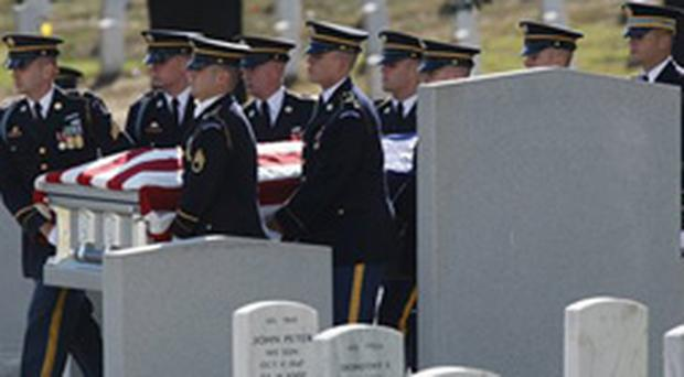 While George Bush made his latest request for funds, more US soldiers were buried at Arlington National Cemetery in Virginia