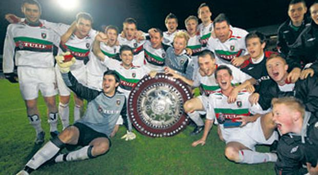 Jubilant Glentoran players celebrate their Co. Antrim triumph following a 2-1 victory over Crusaders at Windsor Park