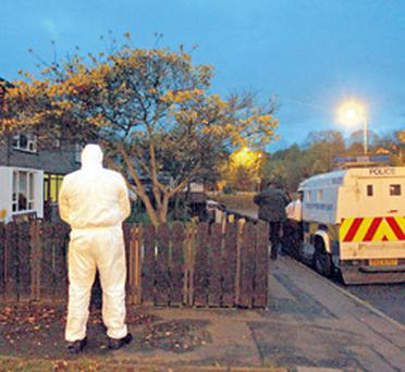 A forensic officer at the house where the woman's body was discovered yesterday