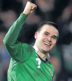 David Healy punches the air after he delivers the knock-out blow to Denmark