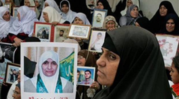 Mothers od Palestinians jailed in Israel attend the weekly demonstrations yesterday at the Red Cross in Gaza