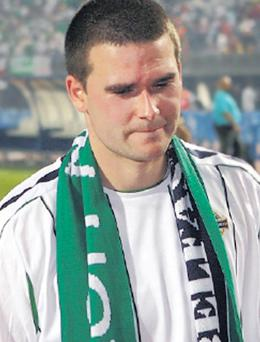 A dejected David Healy leaves the Las Palmas pitch after Northern Ireland's defeat at the hands of Spain.