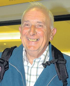 Ship shape: MS Explorer survivor Raymond King arrives at George Best Belfast City Airport last night