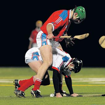 Donal O'Grady is hounded by Eoin Murphy in the vodaphone All Stars game in New York