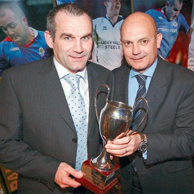 Glenn Ferguson receives his Umbro Northern Ireland footballer of the year award from Ray Wilkins at the Stormont Hotel last night