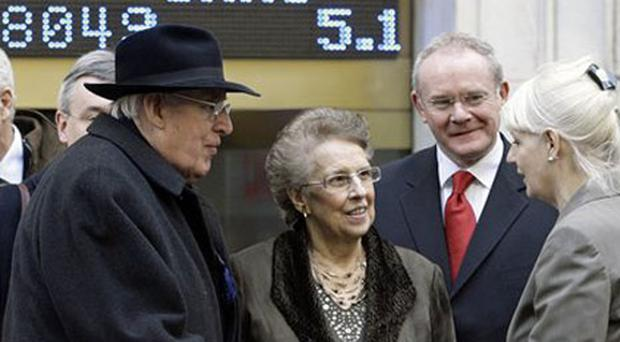 Pictured from left to right, First Minister Dr. Ian Paisley, his wife Eileen, and Deputy First Minister Martin McGuinness, say goodbye to a NYSE representative as they depart the New York Stock Exchange, Monday, Dec 3, 2007