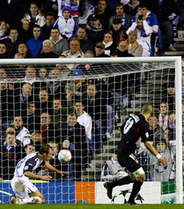 Karim Benzema of Lyon scores during the UEFA Champions League, Group E match between Rangers and Lyon at Ibrox Stadium