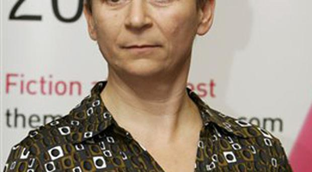 Irish writer Anne Enright holds a copy of her book after she won the Man Booker fiction prize for