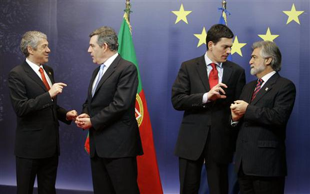 Gordon Brown and David Miliband, the Foreign Secretary, consult their Portugese counterparts, Prime Minister Jose Socrates, left, and Luis Amado, right, yesterday