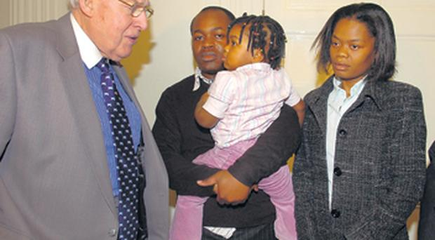 Ian Paisley chats with the Kazadi family at Stormont yesterday