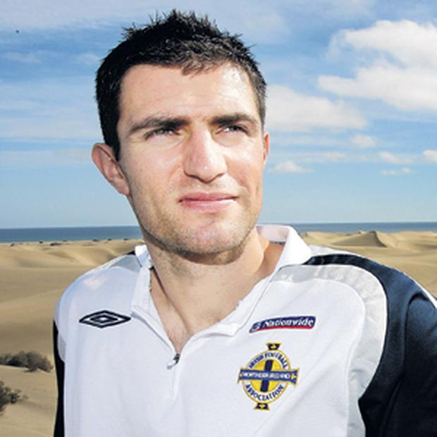 Aaron Hughes believes Nigel Worthington can deliver World Cup glory for Northern Ireland