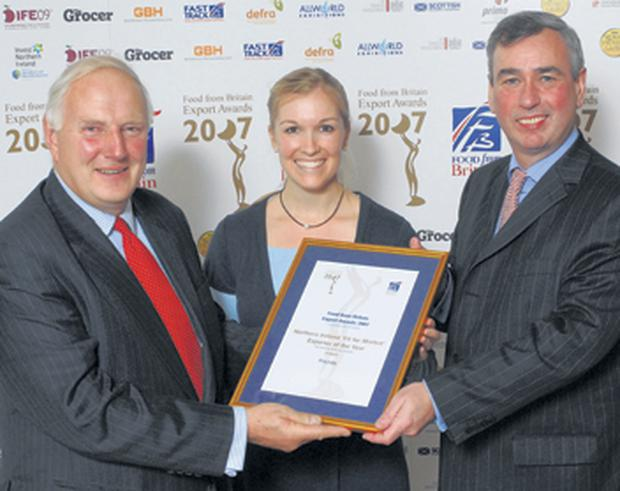 Robert Turner (left) and Georgie Scott of Newtownards-based Pritchitts receive the Food From Britain award from John Speers of the Department for Agriculture and Rural Development