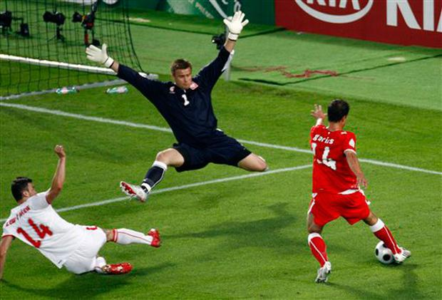 Austria's Gyorgy Garics, right, attempts to kick the ball past Poland's Artur Boruc, center, and Poland's Michal Zewlakow, left, during the group B match between Austria and Poland in Vienna, Austria, Thursday, June 12, 2008, at the Euro 2008 European Soccer Championships in Austria and Switzerland. (AP Photo/Fabian Bimmer)