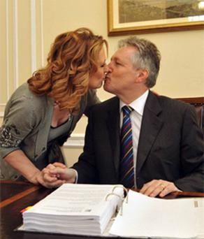 Peter Robinson shares a kiss with wife Iris in the First Minister's office at Stormont