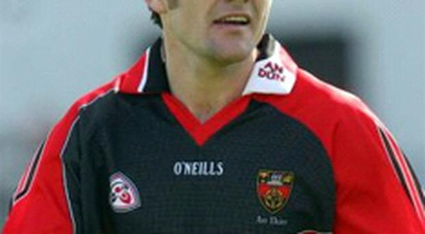 Martin Cole is crucial to Down's defence