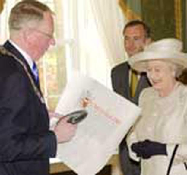 <!-- Enter image here --> <!-- Enter caption here -->The Queen confers city status on Lisburn and Newry.
