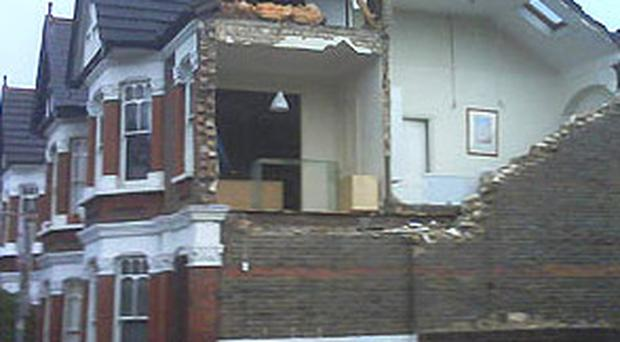 Damage to a house hit by the tornado which struck Kensal Rise, London
