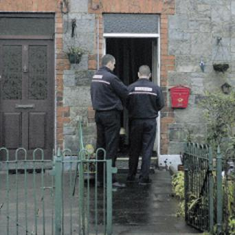 Members of the Fire Service at the house in Bessbrook where Mr McConnell lost his life