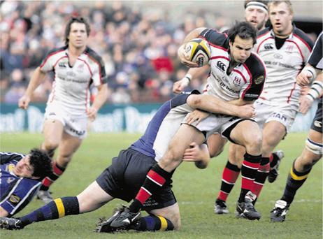 Ulster's Mark Bartholomeusz is tackled by Leinster's Stephen Keogh