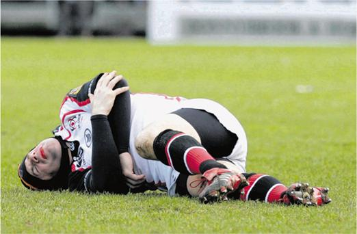 Ulster legend David Humphreys lies on the Lansdowne Road surface in agony after suffering a suspected double fracture in his left arm