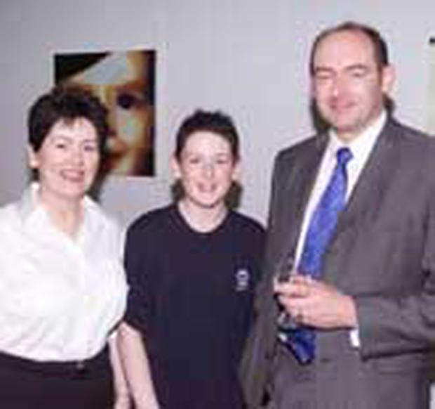 "<!-- Enter image here --> <font face=""Arial, Helvetica, sans-serif"" size=""2"">Jackie Darcy, John Darcy and John Darcy at the exhibition</font>"