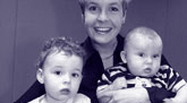 <!-- Enter image here --> <!-- Enter caption here -->Ulster Television's Gillian Porter with her children, Zara and Sam.