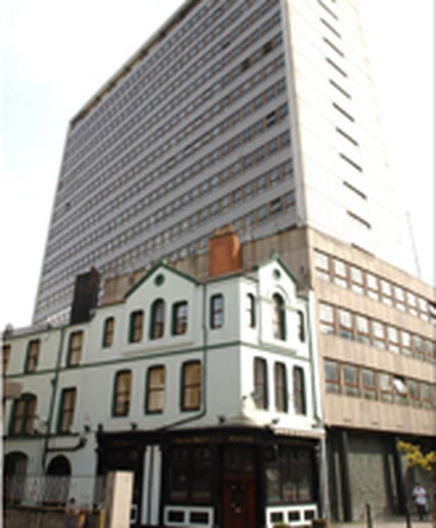 "<!-- Enter image here --> <font face=""Arial, Helvetica, sans-serif"" size=""2"">Facing the chop... the historic Kichen Bar, foreground, will go but the high rise Churchill House will remain</font>"