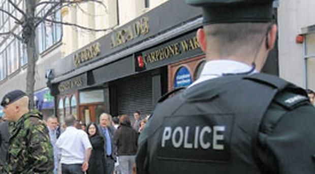 DAYLIGHT ROBBERY<br/>Armed gang targets jewellers