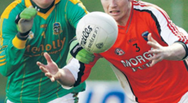 Meath's Graham Geraghty and Brendan Donaghy of Armagh do battle