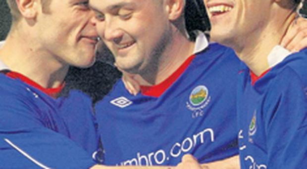 Oran Kearney (left) and Peter Thompson (right) congratulate Paul McAreavey after the midfielder's second goal for Linfield against Glentoran