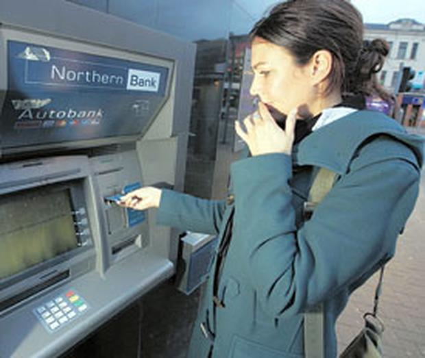 Claire McNeilly tries, and fails, to get money out of a stricken Northern Bank ATM in Belfast