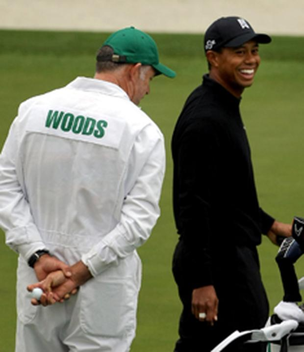 Tiger Woods (right) jokes caddie Steve Williams during yesterday's practice session ahead of the 2008 Masters Tournament