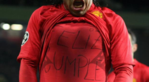 Carlos Tevez celebrates scoring against Roma last night