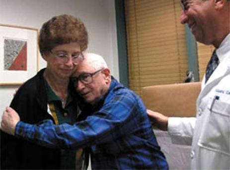 Marvin Millar hugs his wife, whom he had not recognised for years, after the injection