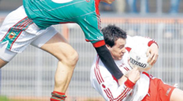 Brian McGuigan (right) came through his first start for Tyrone in two years with flying colours
