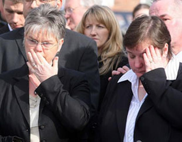 Sisters Barbara and Julie follow the coffin of their father Dickie at his home in Burren Way in east Belfast