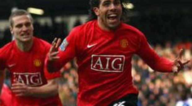 Joy unconfined for Carlos Tevez (right) after his late header earned a point and leaves United three clear of Chelsea
