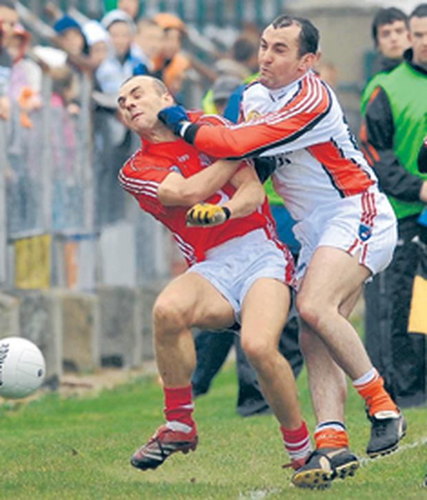 Armagh's Martin O'Rourke gets to grips with John Miskella of Cork